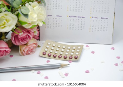 Contraceptive Pencil and calendar placed on the floor.