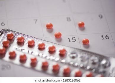 Contraceptive pill Prevent Pregnancy Contraception concept / Birth Control with calendar background - health care and medicine Oral contraceptive pills