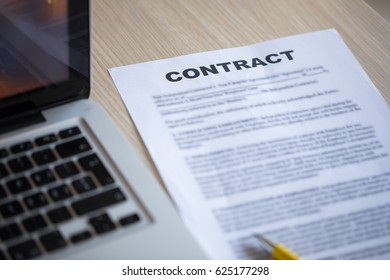 Contract document and lap top