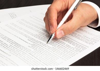 Contract Document signed with hand and pen
