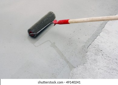 Contract painter painting garage floor to speed up selling of home