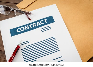Contract papers on wooden table