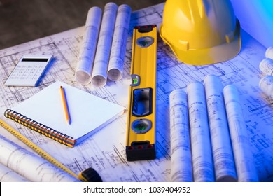 Contractor concept background. Blueprints, hard hat, level, ruler, calculator. Place for typography.
