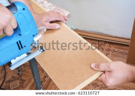 Contractor Cutting Laminate Flooring Lengthwise Workers Stock Photo