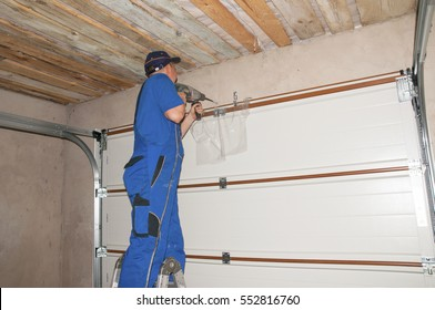 Contractor Installing Garage Door Opener. Garage door springs, garage door replacement, garage door repair.