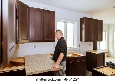 Contractor installing a new laminate kitchen counter top
