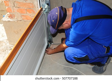 Contractor Installing, Repair, Insulating Garage Door. Garage door seal, garage door springs, garage door replacement, garage door repair.