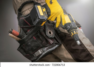 Contractor with Power Tool. Construction Worker with Drill Driver Pro Tool in Hand. Closeup Photo. Preparing For the Job.