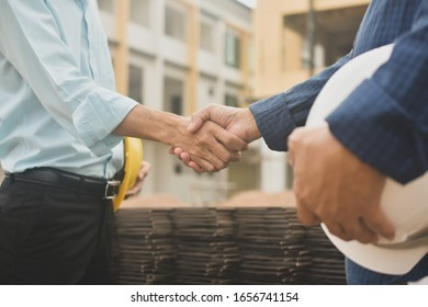 Contractor shake hand agreement success work at estate building construction site