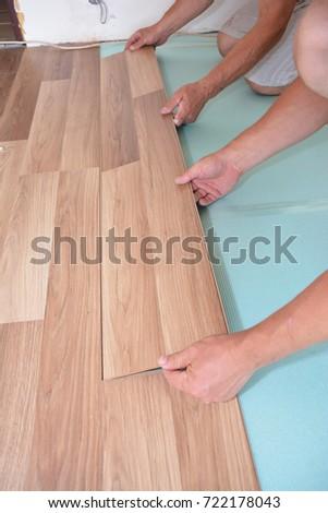 Contractors Installing Wooden Laminate Flooring Insulation Stock