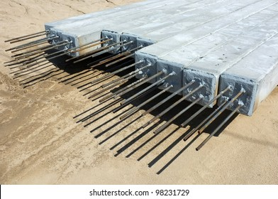 Contractor's lay down area for storage of precast concrete pilings used on a bridge construction project