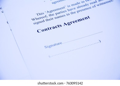 contracts agreement sign on document paper with red pen