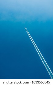 Contrail In Blue Sky. Plane, aircraft, airplane In Sky With Plane Trails. Copy space