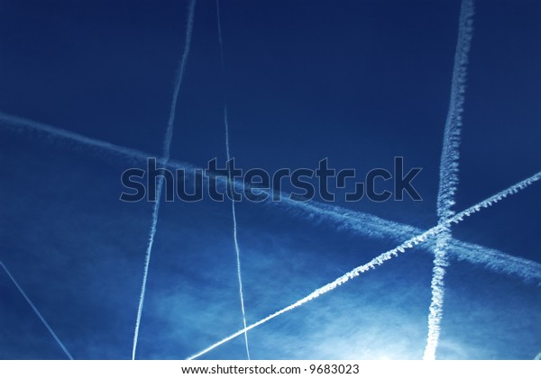Contrail in the dark blue sky, a beautiful show