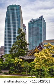 Contrast between Historic Buddhist Temple and Modern Tall Skyscrapers (Tokyo, Japan).