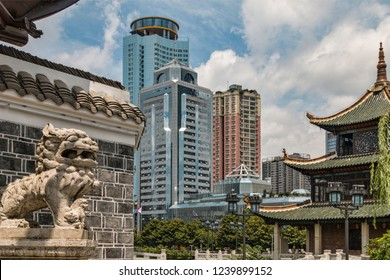 Contrast between Historic Traditional Chinese Architectural Buildings and Buddhist Iconography with Modern Office Tower Skyline of Provincial Capital City (Guiyang, Guizhou Province, China).