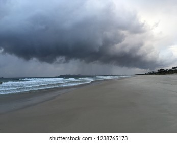 A contrast between light and dark and stormy clouds as water vapour connects sea to sky.