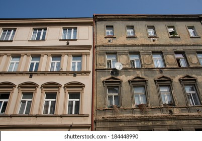 Contrast between old buildings one plaster is repaired and looks good and second is in bad condition.
