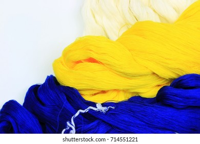 Contrast color concept by dark blue and lemon yellow cotton yarn with space background