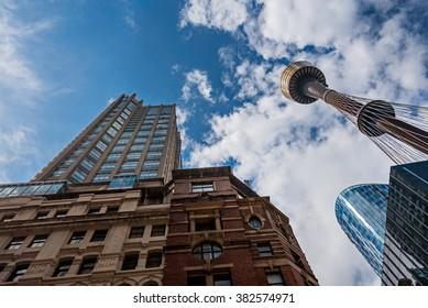 Contrast of old and new buildings in sydney looking upwards