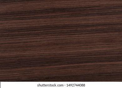 Contrast rosewood veneer background in dark color. High quality