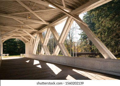 Contrast of shadows and light Inside an old covered bridge on a sunny day.