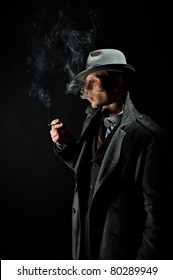 Contrast tinted in the old-style portrait of a man in a stylish elegant business suits, smoking cigarettes