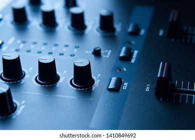 Contrastful Close-up of Club DJ mixer used in Electronic Dance Music production studio