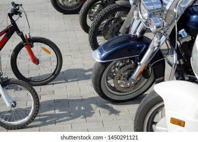 Contrasting and comparing bicycles and motorcycles in the parking lot. Active lifestyle.