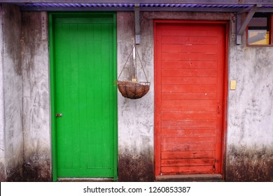 Contrasting green and red doors at Ci Ci Nan Cun village in Taipei