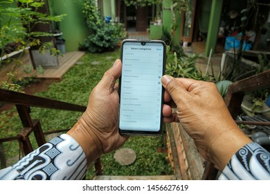 A contributor is choosing the category of photos that will be uploaded to Shutterstock in Bekasi, West Java, Indonesia, on July 20, 2019.