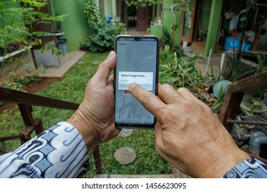 A contributor is choosing a photo from the gallery to upload to Shutterstock in Bekasi, West Java, Indonesia, on July 20, 2019.