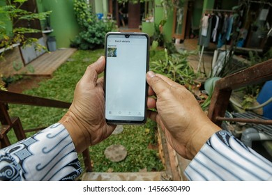 A contributor was happy because his photo was approved by Shutterstock in Bekasi, West Java, Indonesia, on July 20, 2019.