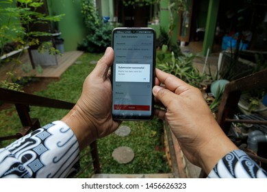 A contributor was happy because the photo uploaded to Shutterstock was approved in Bekasi, West Java, Indonesia, on July 20, 2019.