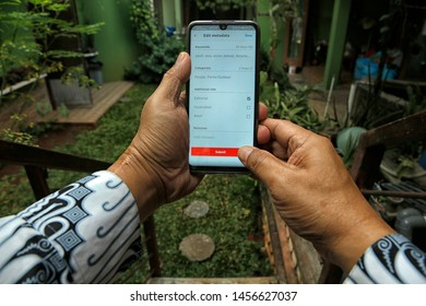 A contributor submits a photo to Shutterstock in Bekasi, West Java, Indonesia, on July 20, 2019.