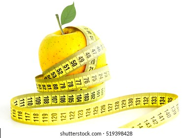 Control of diet results concept with measurement tape and green apple on white background