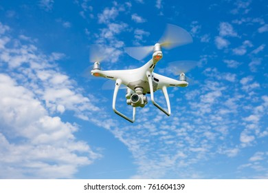Control of the drone against the blue sky