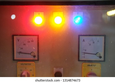 The control panel of the electric device is of vintage type. Multi-colored blurred lights of the bulbs.