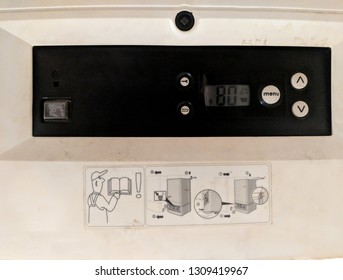 Control panel of gas combi boiler central heating and hot water with some engineer instructions on a sticker beneath it