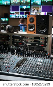 control panel with mixers and microphone in a television studio
