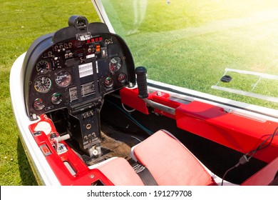 Control panel in the small cockpit of a microlight plane.