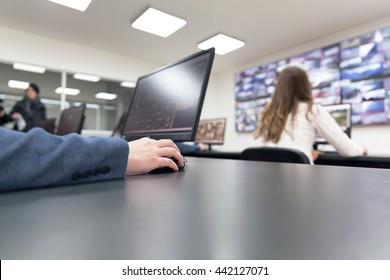 Control room operators. Security video surveillance.