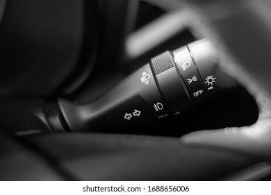 Control switch power light system of car right side steering close up.Left-right turn signal, Blinker, high beam, headlight, fog light.