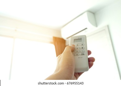 Controlled air conditioning Turn off air conditioning remote. Energy saving concept.