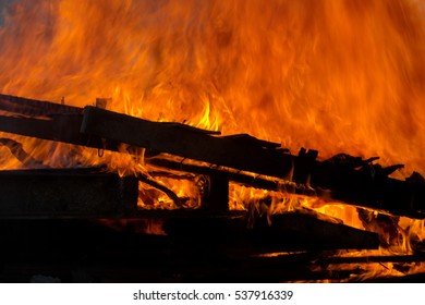 The controlled fire of an old building.