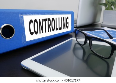 CONTROLLING Office folder on Desktop on table with Office Supplies. ipad