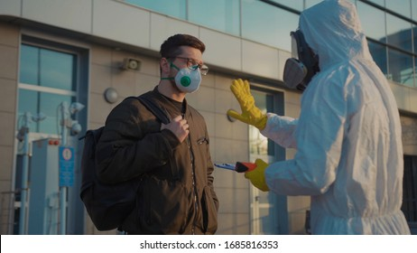 Controlling people's temperature at the entrance to airport railway station check man the Covid-19 symptoms coronavirus checkpoints International airports mask infection epidemic corona slow motion