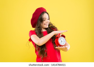 Controlling personal time. Define own rhythm of life. Schedule and time. Set up alarm clock. Child little girl hold red clock. Always on time. It is never too late. Everything is under control.