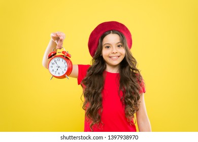 Controlling personal time. Schedule and time. Set up alarm clock. Child little girl hold red clock. Always on time. It is never too late. Everything is under control. Define own rhythm of life.