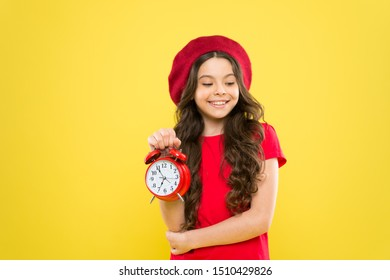 Controlling personal time. Set up alarm clock. Child little girl hold red clock. Always on time. It is never too late. Everything is under control. Define own rhythm of life. Schedule and time.